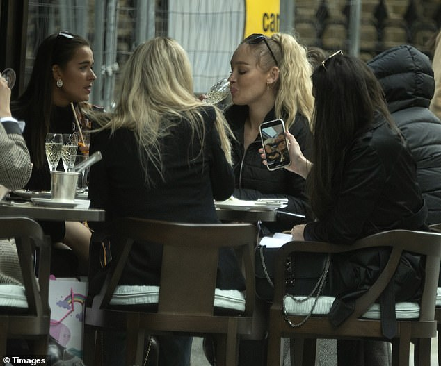 Finally out: Blonde beauty Roxy enjoys a sip of some prosseco as lockdown restrictions ease and outdoor eating is allowed