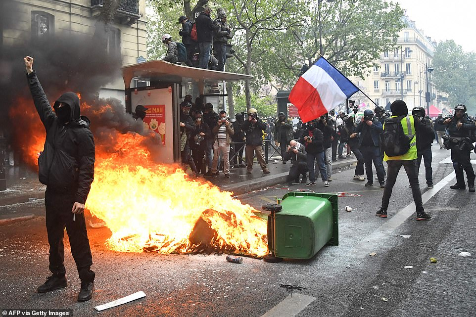 PARIS, FRANCE: 46 people had been arrested at protests in Paris by mid-afternoon, after demonstrators set garbage bins on fire and smashed the windows of a bank branch in the city centre
