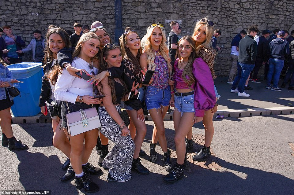 A group of women pose together this evening in Liverpool as they wait to enter Circus night club to attend a Covid-19 pilot event