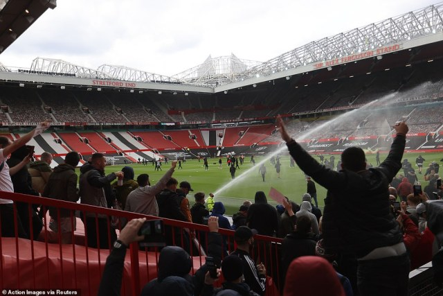 Hundreds of Manchester United fans have stormed the pitch at Old Trafford in protest at the club's American owners ahead of Sunday afternoon's match with Liverpool