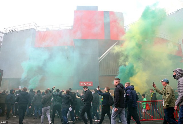 Protesting fans set off smoke flares outside Old Trafford as they make their feelings known before some got inside