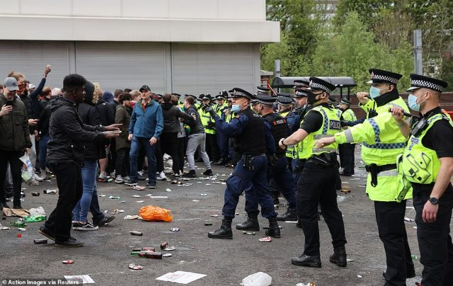 Bottles and other projectiles were hurled at the riot officers from the protesting fans as tensions escalated