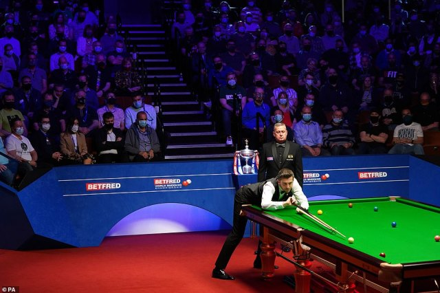 Meanwhile snooker fans at Sheffield's Crucible Theatre were required to wear masks but did not need to socially distance as part of another test event