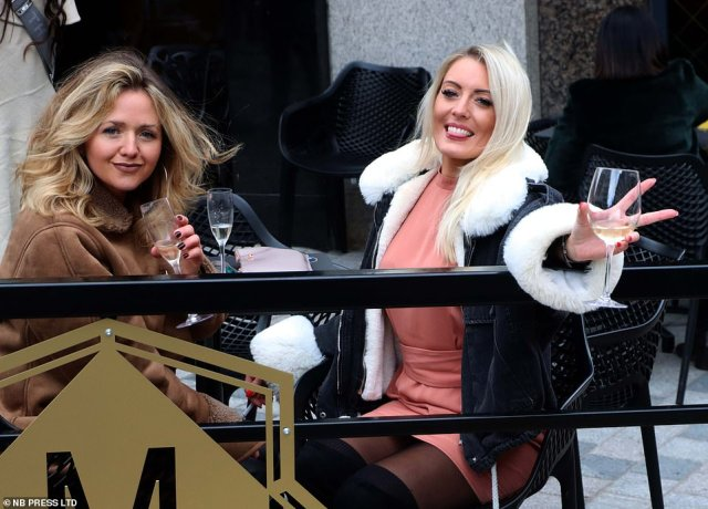 A group of friends sit outside and enjoy a drink as theytoast in the May Bank Holiday and take advantage of the first three-day weekend since Covid rules were relaxed