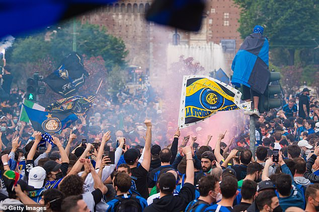 Inter fans celebrate in Milan after ending Juve's dominance of the Italian top flight on Sunday