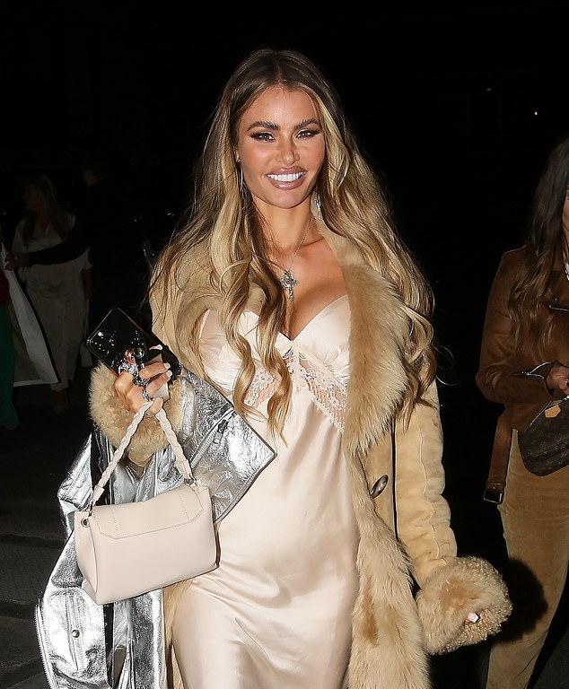 All smiles:Chloe made sure she looked every inch the beauty queen as she sported a full face of glamorous make-up and styled her caramel tresses in loose waves