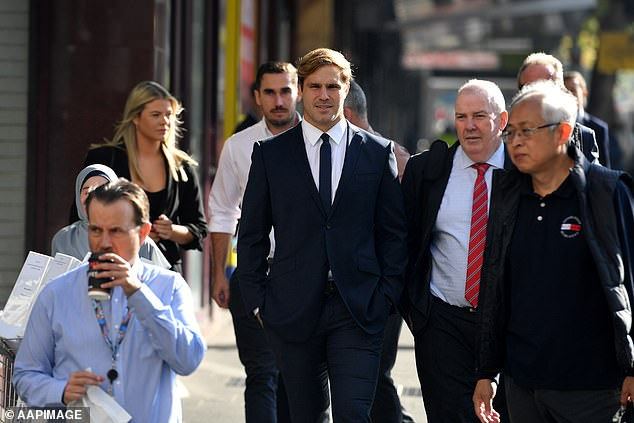 Jack de Belin (centre) will learn his fate soon as the jury retired in his rape retrial on Monday