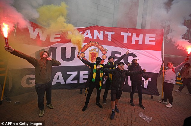Manchester United fans protesting against the club's American owners, the Glazer family, forced the postponement of Sunday's Premier League game against Liverpool