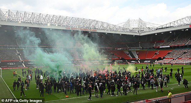 The crowd that stormed Old Trafford lit smoke flares and swung from the goal posts