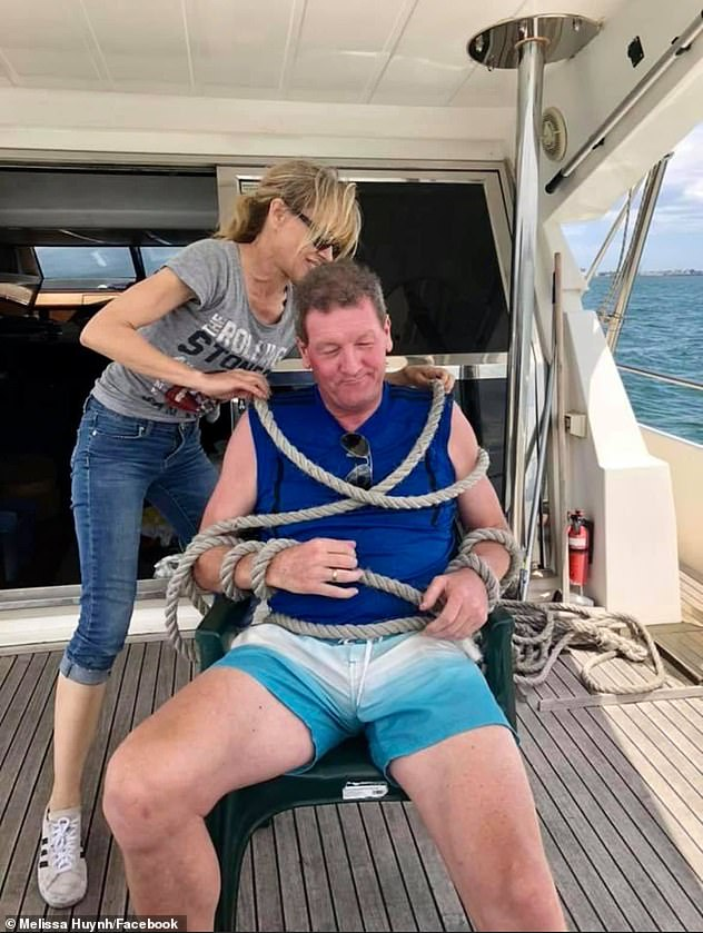 Amanda Brown ties up former player agent, and mate, Ricky Nixon (pictured) during another day on the water