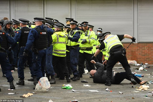Police were forced to push back to clear the Old Trafford concourse, leaving behind a devastating mess across the streets