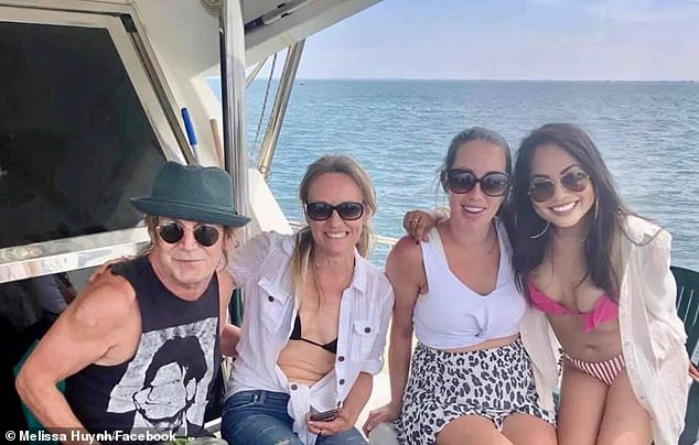 Amanda Brown (second left) is pictured on another day on the water with singer Brian Mannix (left) and two other friends