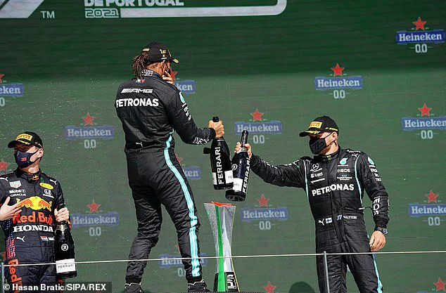 Lewis Hamilton (centre) celebrates his Portuguese Grand Prix victory with Valtteri Bottas (R)