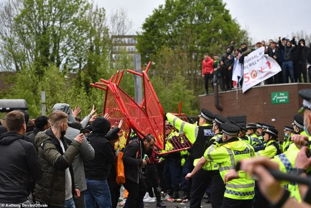 Manchester United fans who got inside the Munich Tunnel and forced open an access door were responsible for letting in more than a hundred fellow protesters during Sunday¿s demonstration at Old Trafford, it has been revealed. Pictured, Police battle with United protesters as red steel barriers are thrown into the air