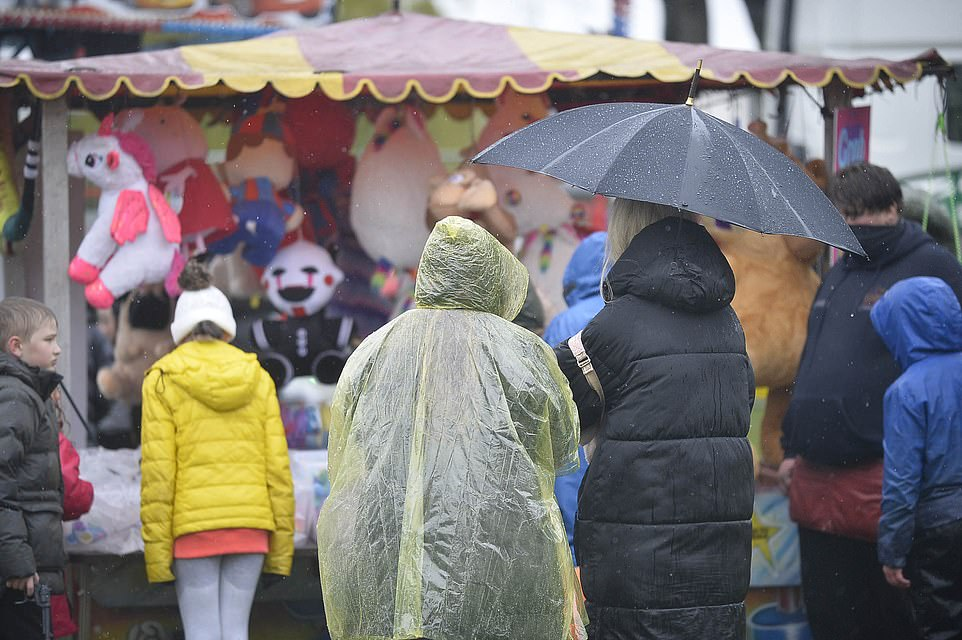 The wet bank holiday hasn't stopped families enjoying themselves at an open air funfair in Huddersfield, Yorkshire