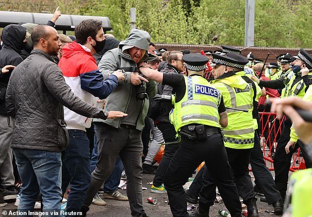 Tensions escalated when police moved in to move the protestors away from the Old Trafford forecourt with batons drawn