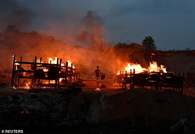 Bodies of Covid victims are burned at a cremation ground inGiddenahalli village on the outskirts of Bengaluru