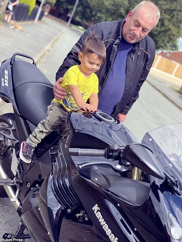 Darren who works as a lorry driver, had just one to two days a week available to build the house bed. Pictured:Zair with his granddad Darren Evans