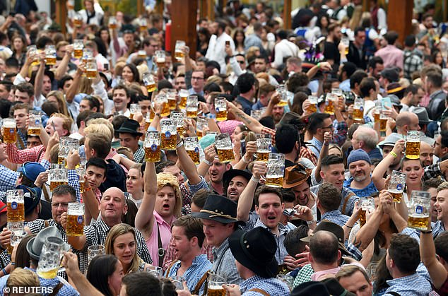 Reiter said the cancellation was `` a great pity '' for the festival's millions of fans, with `` existential consequences '' for people's livelihoods.  Above, people cheer with huge pints of beer at the start of Oktoberfest 2019
