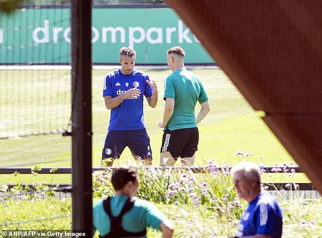 Van Persie's first coaching role has seen him help train Feyenoord's strikers this season (above)