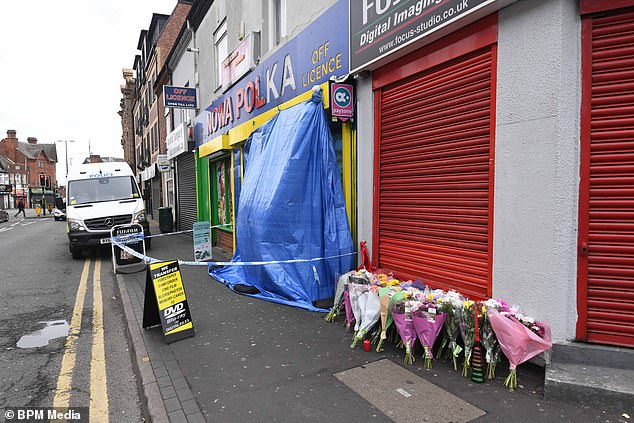 Police said they understood that 10 minutes before Derlarno was taken to hospital he was chased into a Waterloo Road store and stabbed (pictured: floral tributes left outside a Smethwick store after the death of Derlarno in the knife attack)