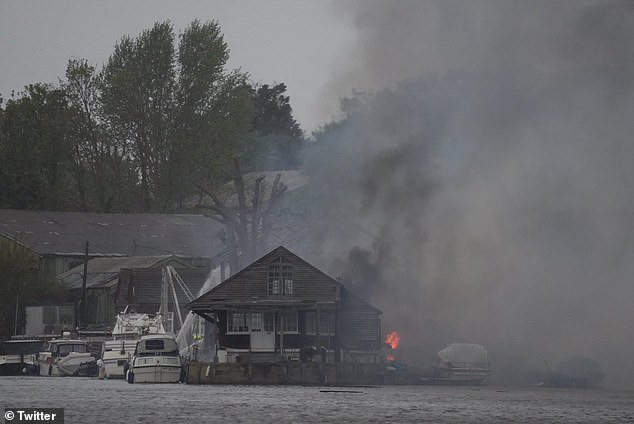 Another shared an image of the aftermath of the fire as heavy rain poured on the scene, writing: 'The wind whipped it up... then the rain helped to douse'