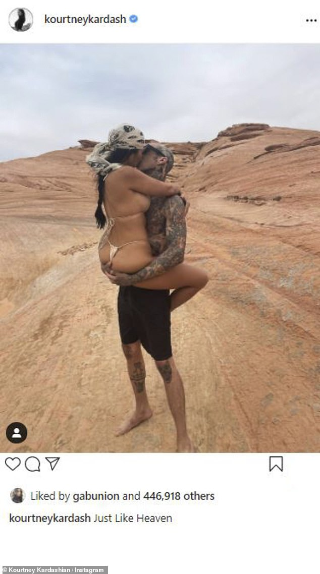 A new man in her life: And Kourtney Kardashian is dating Travis Barker; here they are seen in Utah and she said being held by him was 'just like heaven'