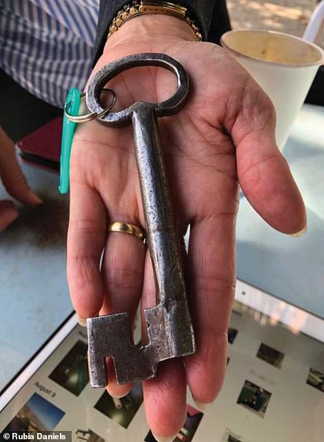It's got history! Daniels shows off an old house key