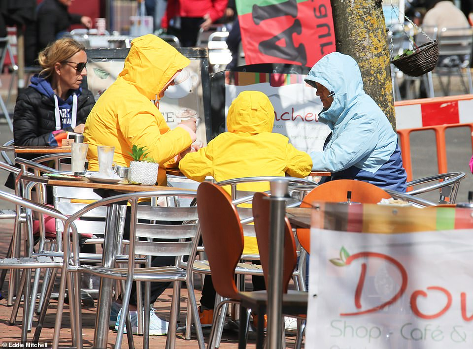 Diners were seen in raincoats outside a restaurant in Worthing, West Sussex this morning