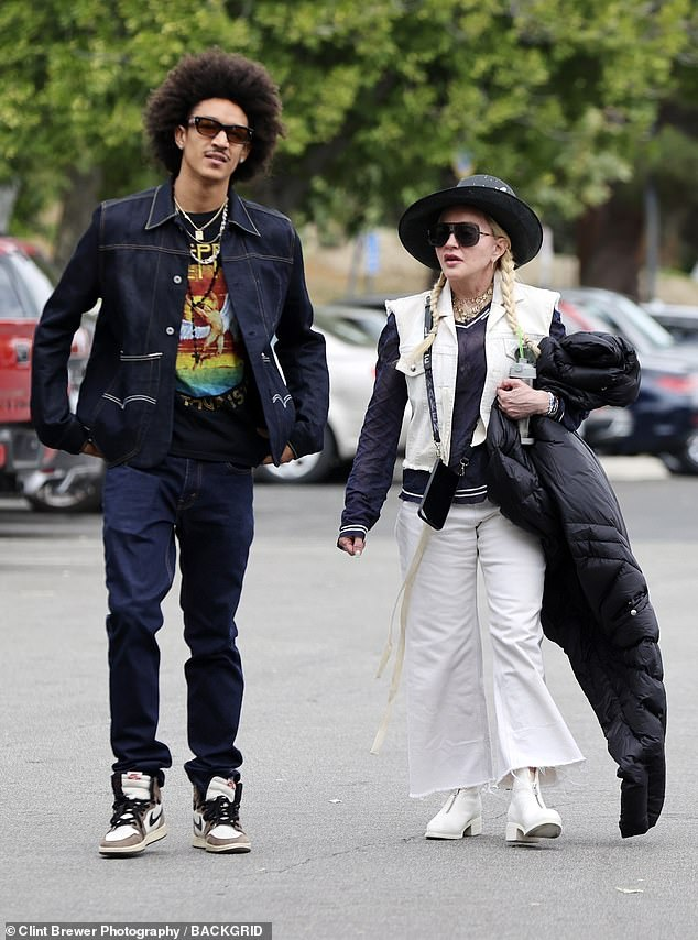 Showing her style: She also donned relaxed fit white jeans along with avant-garde platform booties