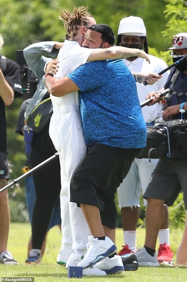 Celebrate: Frequent collaborators shared a hug after Bieber's perfect putt