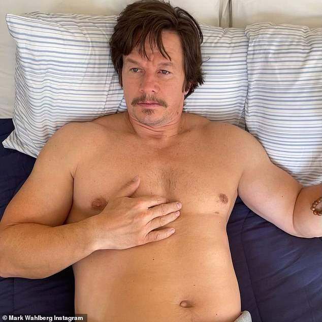 Just temporary: The second snap, taken after he purposely packed on the pounds, captured him laying in bed, looking visibly heavier without his washboard abs