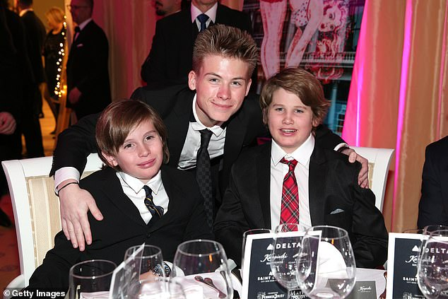Her boys: The 63-year-old actress adopted her three sons because an autoimmune disease made it difficult for her to carry a pregnancy to term.  Pictured: Sharon's sons (left to right) Quinn, Roan and Laird in December 2017
