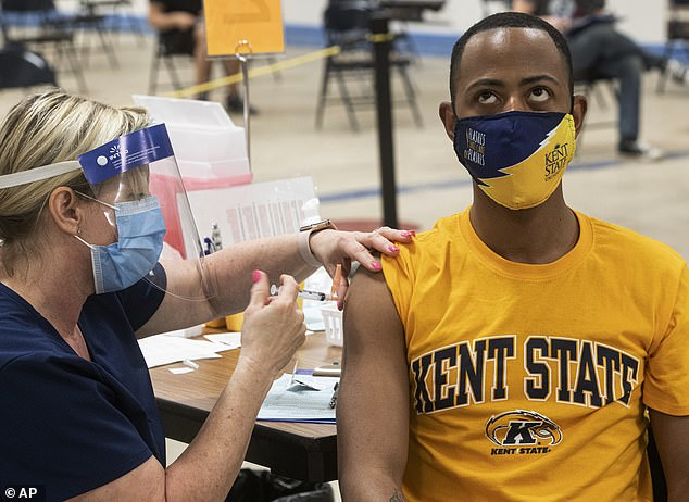 Kent State University student Marz Anderson gets his Johnson & Johnson COVID-19 vaccination from Kent State nurse Beth Krul in Ohio on April 8, 2021