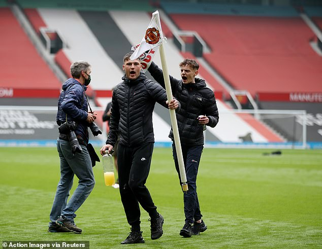Fans chanted 'Glazer Out' as they made their way across the pitch on Sunday