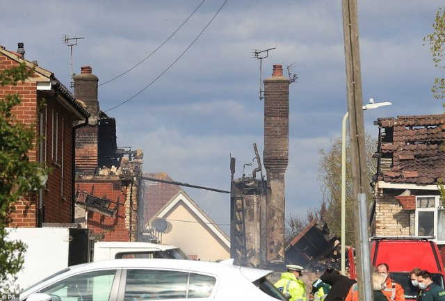 A chimney stack remained tottering among the wreckage of the property this morning as emergency services cared for casualties