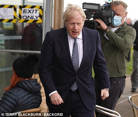Prime Minister Boris Johnson has refused to budge on calls for lockdown to be ended sooner but sounded optimistic yesterday, when he said: 'We have got a good chance of being able to dispense with the one-metre plus from June 21.' (Pictured on a campaigning visit to Hartlepool yesterday)