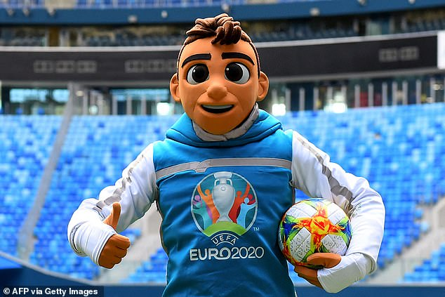 Skillzy, the official Euro 2020 mascot, poses with the matchball at Saint Petersburg Stadium