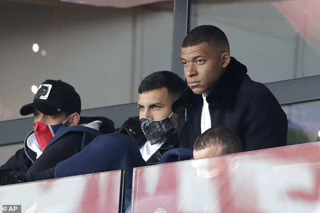 The French superstar (right) watched on from the sidelines with a calf injury against Lens