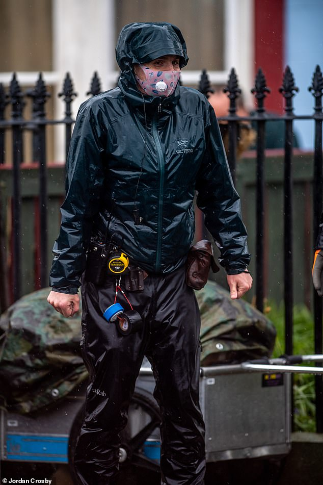 Drenched: As well as the actors, the film crew were also drenched in the downpours despite wearing waterproof clothing