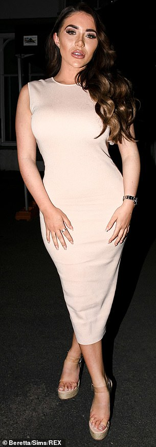 Stepping out: She paired her look with a pair of perspex wedges and sported a full coverage make-up look