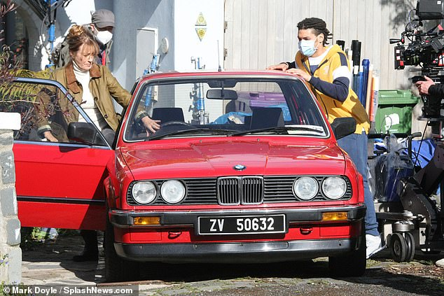 First Look: Jane Seymour, 70, was spotted driving a vintage red BMW as she performed on the set of her upcoming Irish mystery thriller Wild Harry, after filming began in Ireland