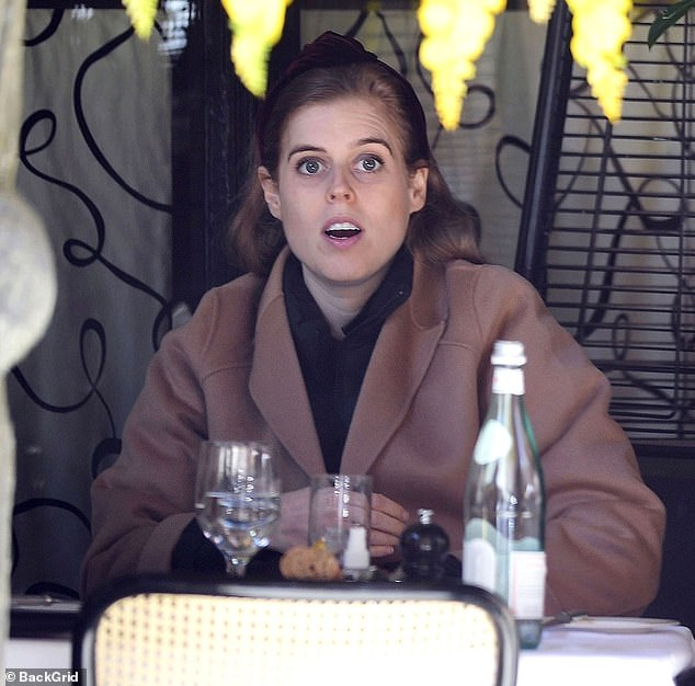 Princess Beatrice opted to wear a camel jacket with a black scarf and velvet red headband for the occasion
