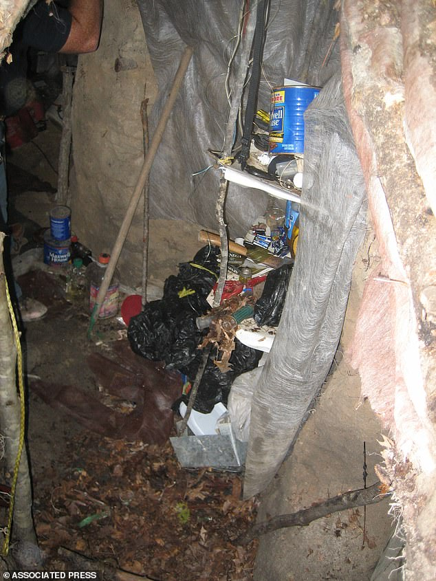 Filyaw held Elizabeth Shoaf hostage in a six-feet-deep underground bunker that he had built (pictured). The lair was booby-trapped with explosives and had a camouflaged door