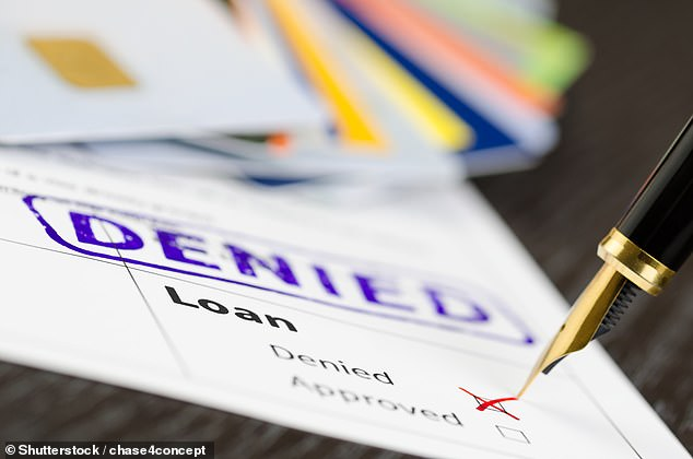 Bank credit officers are more likely to approve loan requests early and late in the working day ¿ and reject those processed around 12pm, a study found (stock image)