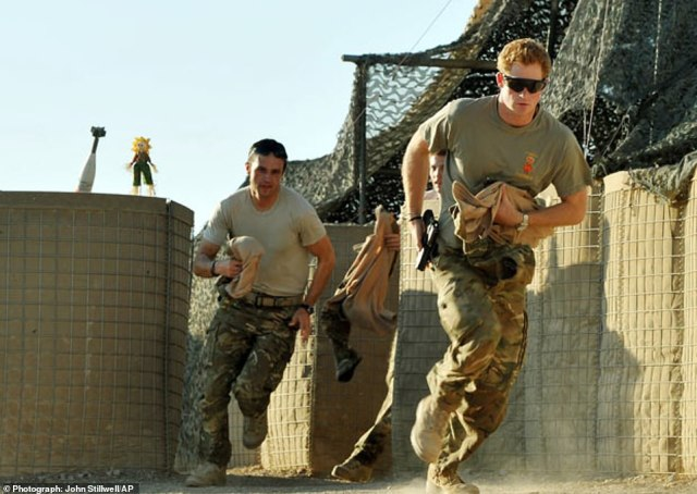 Prince Harry (right) in military fatigues while on a tour of Afghanistan. He served in the Blues and Royals 662 Squadron 3 Regiment Army Air Corps