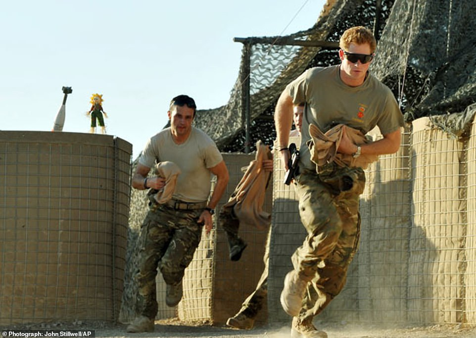 Prince Harry (right) in military fatigues while on a tour of Afghanistan. He served in theBlues and Royals 662 Squadron 3 Regiment Army Air Corps