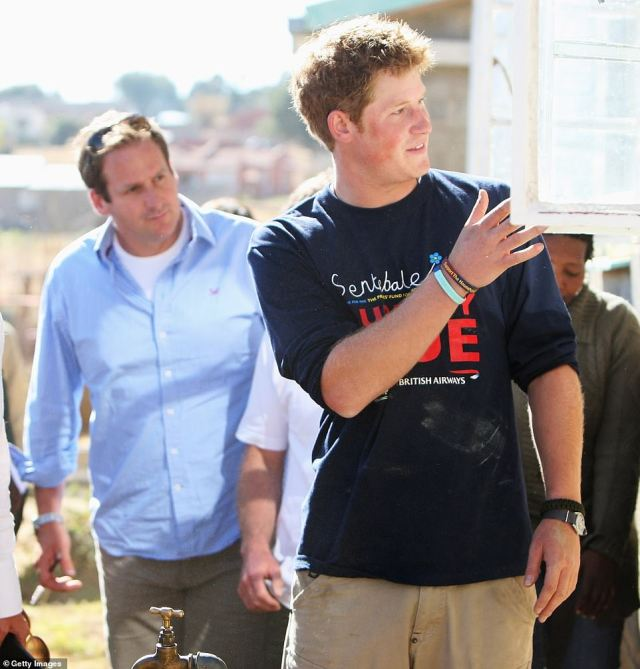 Duncan Larcombe, author of Prince Harry: The Inside Story, got to know the Duke of Sussex, 36, during his decade-long stint as a royal editor and described him as 'hot-headed' (pictured with Harry in 2008 in Buthe Buthe, Lesotho)
