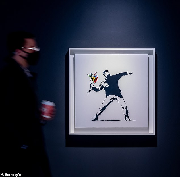 Sotheby's will sell this Banksy painting, called Love is in the Air, on May 12. It will be the first ever fine art auction sale that will let buyers pay with cryptocurrency