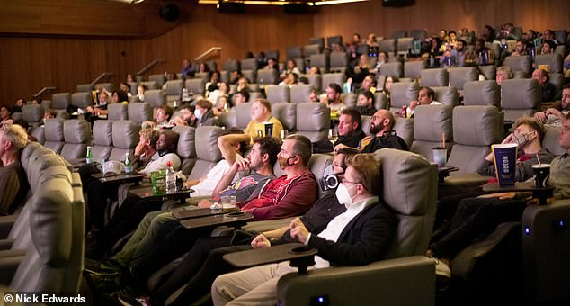 Bosses will introduce strict social distancing measures and screens will not be able to be at full capacity.  Pictured: Odeon in Leicester Square last year